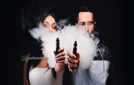 Фото - Парень и девушка курят vape
